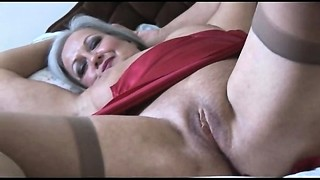 Fetching bust grandma in slip and stockings unwraps
